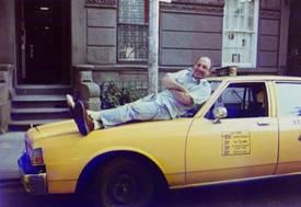 Gabby Cabby laying on cab hood